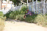 ELDERLY MEXICAN MAN SITS on WALKWAY<br />