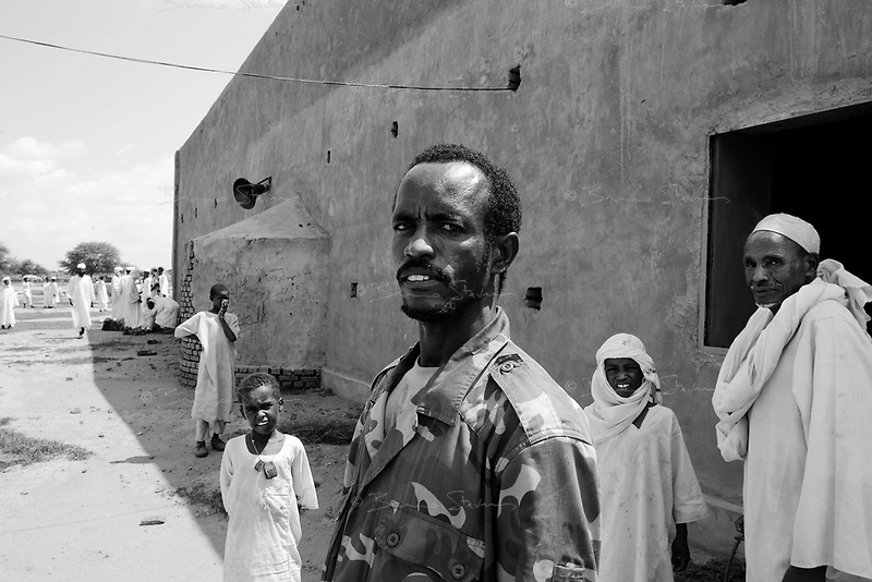 Mastariya, North Darfur, August 13, 2004.Bakhit, a Janjaweed after his Friday prayer. Men from this village are Arabs from the Rezeghat tribe, most of them are enlisted in Janjaweed militia after Musa Hillal, their Sheikh, gave full support to the Khartoum government allegedly to fight the SLA rebels.