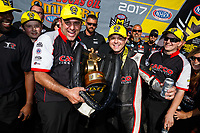 May 7, 2017; Commerce, GA, USA; Crew member Bobby Lagana (left) and NHRA top fuel driver Steve Torrence celebrate after winning the Southern Nationals at Atlanta Dragway. Mandatory Credit: Mark J. Rebilas-USA TODAY Sports
