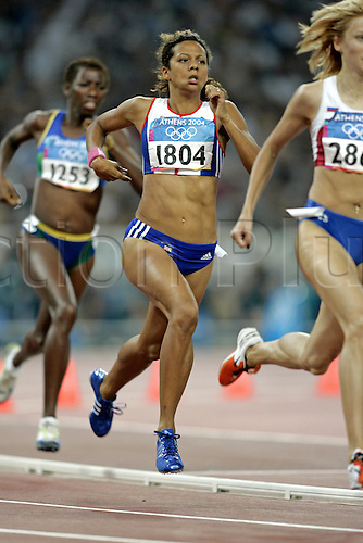 21 August 2004: British runner Jo Fenn (GBR) running in the 3rd Semi-Final of the Women's 800m held in the Olympic Stadium. 2004 Olympic Games, Athens, Greece. Photo: Neil Tingle/Action Plus...040821 olympics olympic athletics athlete athletics  track and field women woman meters run runner runners running distance.female