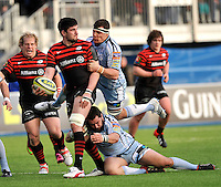 Hendon, England. Eoin Sheriff of Saracens tackled during the LV= Cup match for the first professional rugby game on the artificial turf pitch made for rugby between Saracens and Cardiff Blues at Allianz Park Stadium on January 27, 2013 in Hendon, England.