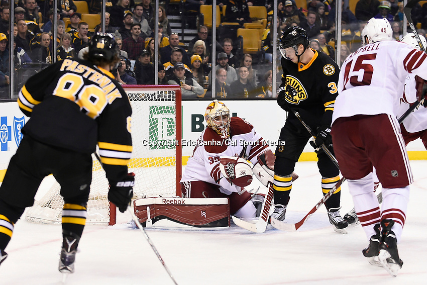 February 28, 2015 - Boston, Massachusetts, U.S. - Arizona Coyotes goalie Louis Domingue (35) makes a glove save during the NHL match between the Arizona Coyotes and the Boston Bruins held at TD Garden in Boston Massachusetts. The Bruins defeated the Coyotes 4-1 in regulation time. Eric Canha/CSM