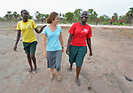 Nicky Hess, a Mennonite volunteer from the United States (center), walks with two students at the Loreto Girls Secondary School in Rumbek, South Sudan. The school is run by the Institute for the Blessed Virgin Mary--the Loreto Sisters--of Ireland.