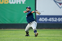 Helena Brewers left fielder Jose Gomez (5) makes a throw to home plate during the game against the Great Falls Voyagers at Centene Stadium on August 19, 2017 in Helena, Montana.  The Voyagers defeated the Brewers 8-7.  (Brian Westerholt/Four Seam Images)