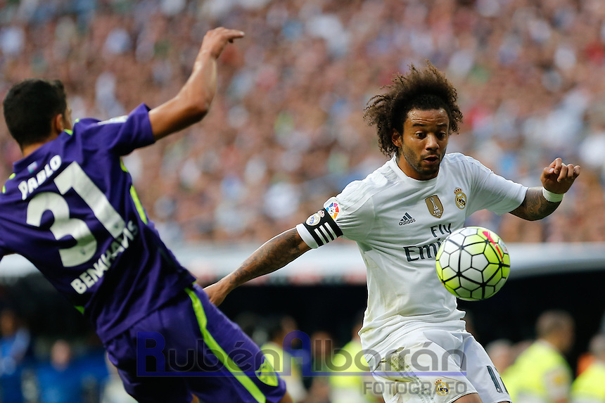 Real Madrid´s Marcelo and Malaga´s Pablo