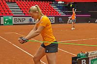 April 16, 2015, Netherlands, Den Bosch, Maaspoort, Fedcup Netherlands-Australia,  Kiki Bertens (NED) warms up in the background Arantxa Rus<br /> Photo: Tennisimages/Henk Koster