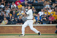 Jonathan Pryor (11) of the Wake Forest Demon Deacons follows through on his swing against the West Virginia Mountaineers in Game Four of the Winston-Salem Regional in the 2017 College World Series at David F. Couch Ballpark on June 3, 2017 in Winston-Salem, North Carolina.  The Demon Deacons walked-off the Mountaineers 4-3.  (Brian Westerholt/Four Seam Images)