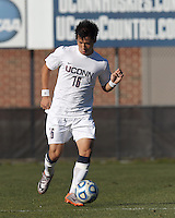 University of Connecticut defender Flo Liu (16) brings the ball forward. .NCAA Tournament. University of Connecticut (white) defeated Northeastern University (black), 1-0, at Morrone Stadium at University of Connecticut on November 18, 2012.
