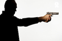 Silhouette of man holding gun against white background (Licence this image exclusively with Getty: http://www.gettyimages.com/detail/sb10068346au-001 )