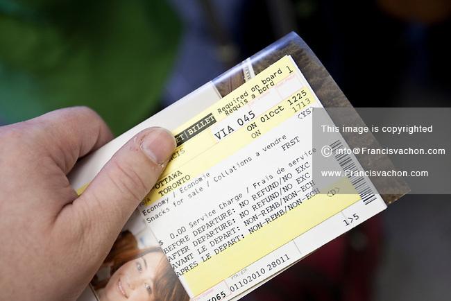 A traveler hold a train ticket from Ottawa to Toronto on train VIA 045 at the Ottawa VIA Rail station Friday October 1, 2010.