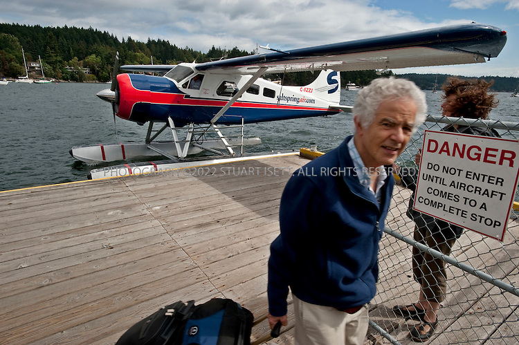 8/25/2009--Ganges, Salt Spring Island, British Columbia, Canada..A seaplane from Vancouver, bringing visitors to Salt Spring Island, unloads passengers in the harbor in the town of Ganges...©2009 Stuart Isett. All rights reserved.