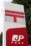 Japan Post Holdings sign on display at the entrance of its headquarters building on October 29, 2015, Tokyo, Japan. The share price for Japan Post Holdings Co. public offering was set at 1,400 yen (11.58) for its debut on the Tokyo Stock Exchange next November 4. This price was at the high end of expectations and the government hopes that many Japanese citizens will take the opportunity to invest in the company. (Photo by Rodrigo Reyes Marin/AFLO)