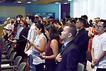 People singing Canadian national anthem, O-Canada, at a Citizenship ceremony in Vancouver, British Columbia, Canada 2018 Image © MaximImages, License at https://www.maximimages.com
