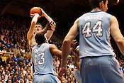 Duke's Kyle Singler shoots against  UNC's Will Graves during the last regular season game against UNC at Cameron Indoor Stadium, Sat., March 6, 2010. Single lead the Blue Devils with 25 points. .