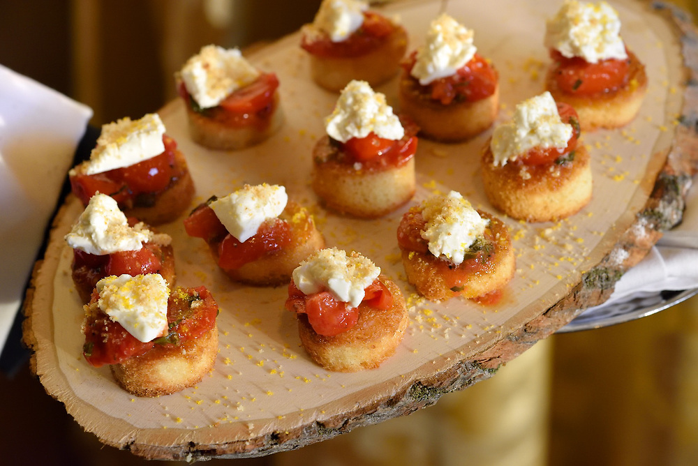 Still photo of hors d'oeuvres being artfully presented at a cocktail reception.