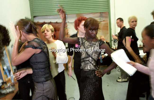 "digefas00007 Fashion. Models and make-up artists preparing before probably the biggest fashion show ever held in South Africa. A show showcasing the 24 best of S. Africa's designers and the best models etc. The event named  ""Nederburg deigner Collection"" was attended by fashion editors from some of the top European fashion magazines at the Grand West Casino about 10 miles north of Cape Town, South Africa on August 22, 2002..©Per-Anders Pettersson/ iAfrika Photos"