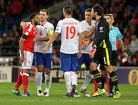 Ashley Williams of Wales (L) squares up against Vladimir Stojkovic of Serbia (R) during the 2018 FIFA World Cup Qualifier between Wales and Serbia at the Cardiff City Stadium, Wales, UK. Saturday 12 November 2016