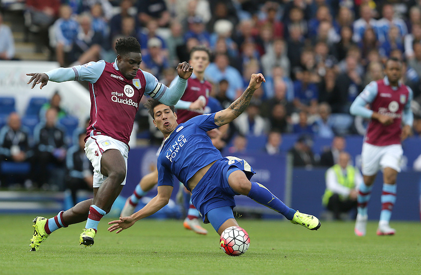 Aston Villa's Micah Richards is tackled by Leicester City's Leonardo Ulloa<br /> <br /> Photographer Stephen White/CameraSport<br /> <br /> Football - Barclays Premiership - Leicester City v Aston Villa - Sunday 13th September 2015 - King Power Stadium - Leicester<br /> <br /> &copy; CameraSport - 43 Linden Ave. Countesthorpe. Leicester. England. LE8 5PG - Tel: +44 (0) 116 277 4147 - admin@camerasport.com - www.camerasport.com