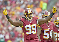 Washington Redskins defensive end Ricky Jean Francois (99) try to get the crowd into the game during second quarter action against the Cleveland Browns at FedEx Field in Landover, Maryland on October 2, 2016.  The Redskins won the game 31 - 20.<br /> Credit: Ron Sachs / CNP /MediaPunch ***EDITORIAL USE ONLY***