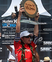 American and Huntington Beach local Brett Simpson holds up his US Open of Surfing first place plaque. 2009 WQS 6 Star US Open of Surfing in Huntington Beach, California on Sunday July 26, 2009. ..
