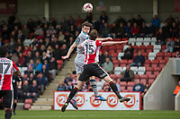Calum Dyson of Grimsby beats William Boyle of Cheltenham Town in the air during the Sky Bet League 2 match between Cheltenham Town and Grimsby Town at the The LCI Rail Stadium,  Cheltenham, England on 17 April 2017. Photo by PRiME Media Images / Mark Hawkins.