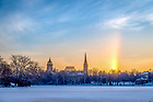 January 2, 2018; Sunrise over St. Mary's Lake with a sun dog at right. The effect is caused by ice crystals suspended in the air. (Photo by Matt Cashore/University of Notre Dame)