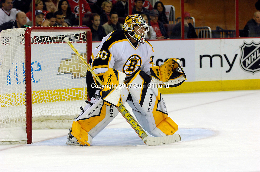 Boston Bruins' goalie Tim Thomas (30) watches the action from the crease Saturday, Feb. 3, 2007 during a game with the Carolina Hurricanes at the RBC Center in Raleigh. Boston won 4-3 in overtime.