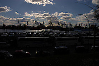 Silhouetted cars and harbour, Hamburg, Germany
