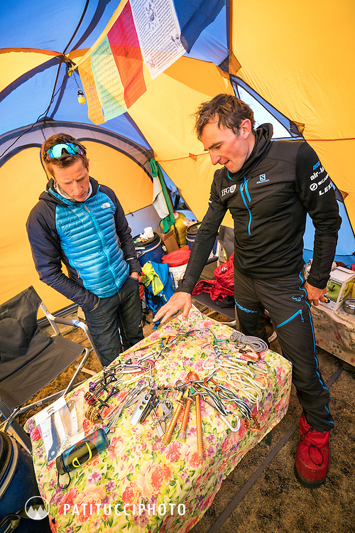 Ueli Steck and David Göttler packing climbing gear inside a basecamp tent during their climbing expedition to the 8000 meter peak Shishapangma, Tibet