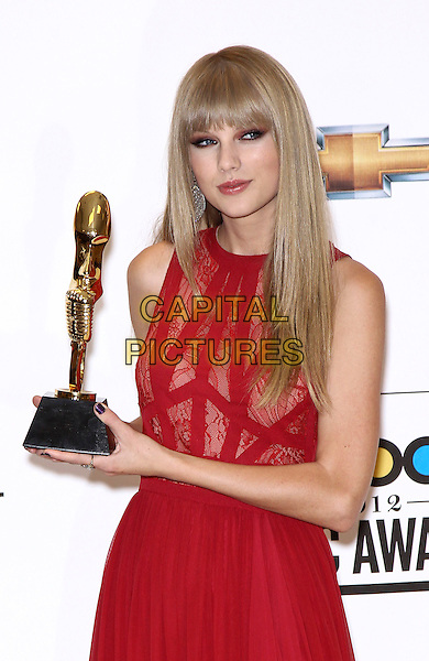 Taylor Swift.2012 Billboard Music Awards Press Room at the MGM Grand Garden Arena Las Vegas, Las Vegas, Nevada, USA..May 20th, 2012.half length red dress lace sleeveless award trophy.CAP/ADM/MJT.© MJT/AdMedia/Capital Pictures.