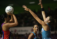 20.03.2010 Mystics Maria Tutaia and Thunderbirds Sharni Layton in action during the ANZ Champs Netball match between the Mystics and Thunderbirds at Trusts Stadium in Auckland. Mandatory Photo Credit ©Michael Bradley.