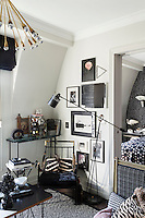 The apartment is a combination of vintage furnishing, eye-catching fabrics and masterly use of space. Furnishings are effectively 18th-century with a slight fashion twist, the monochrome colour scheme, with feminine touches of soft green and pink, giving the overall design a 'dandyish' feel.