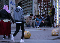 Pictured: Migrant men sit on the ground in Heyden Street Wednesday 09 March 2016<br /> Re: Migrants at Victoria Square, in central Athens, Greece.