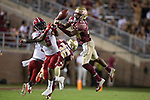 Florida State Seminoles defensive back Asante Samuel Jr. (26) tries to intercept a pass intended for North Carolina State wide receiver Tabari Hines (5) in the second half of an NCAA college football game in Tallahassee, Fla., Saturday, Sept. 28, 2019. Florida State defeated North Carolina State 31-13.   (AP Photo/Mark Wallheiser)