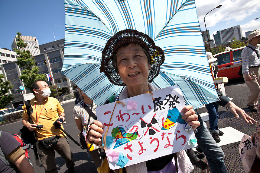 An anti nuclear activist marching at the Women's  Protest outside METI (Ministry of Economy, Trade and Industry) in Tokyo, Japan. Friday June 29th 2012. About 400 protesters campaigned the restarting of the Oi nuclear power-station and the policy of Prime-Minister Noda to restart Japan's nuclear power generation programme which has been stalled since the earthquake and tsunami of March 11th 2011 caused meltdown and radiation leaks at the Fukushima Daichi Nuclear power-plant.