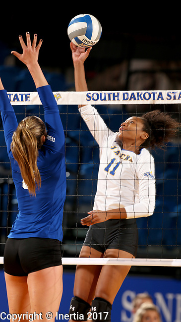 BROOKINGS, SD - SEPTEMBER 1: Payton Richardson #11 from South Dakota State University tips the ball over the net against Sidney Wicks #8 from CSU Bakersfield during their match Friday night at the Jackrabbit Invitational at Frost Arena in Brookings. (Photo by Dave Eggen/Inertia) (Photo by Dave Eggen/Inertia)