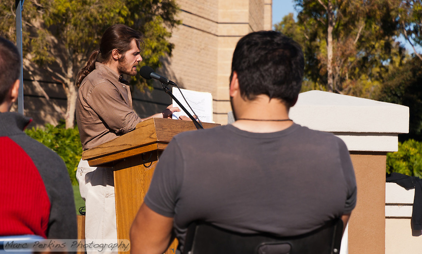 Dan Wolfe speaks and points to a data graph at the Occupy Orange County, Irvine camp on November 5.