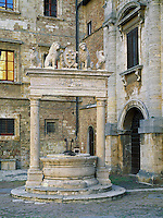 Tuscany, Italy                      <br /> Ornate well in front of the Palazzo Nobili-Tarughi on  Montepulciano's Piazza Grande