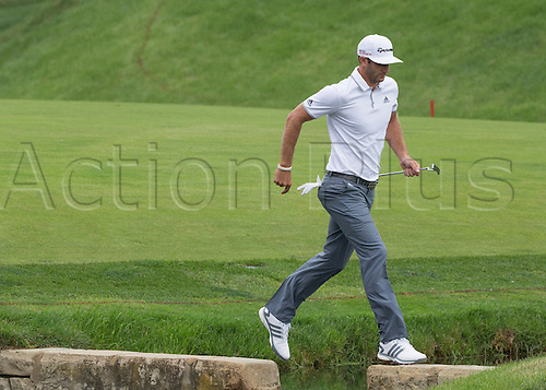 06.06.2015. Dublin, Ohio, USA.  Dustin Johnson jumping over a small creak on hole 14 during the third round of the Memorial Tournament held at the Muirfield Village Golf Club in Dublin, Ohio.