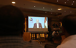 Palestinians watch while Secretary General of the Islamic Jihad Movement Ziad al-Nakhla speaking via a video link during the national meeting coming out of Oslo in Gaza City, on September 17, 2019. Photo by Mahmoud Ajjour