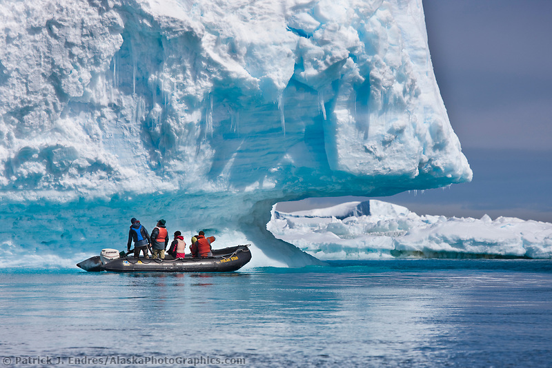 Zodiak ride along a giant iceberg near Paulet Island, Antarctic peninsula.