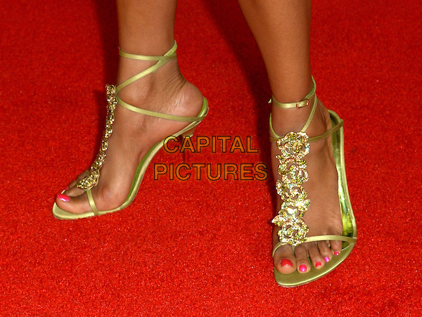 MALINDA WILLIAMS.World Premiere of Johnson Family Vacation held at The Cinerama Dome in Hollywood, California .31 March 2004.*UK Sales Only*.gold strappy lace-up tie-up shoes sandals toes, feet, nail varnish.www.capitalpictures.com.sales@capitalpictures.com.©Capital Pictures.
