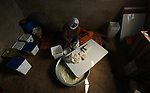 A Palestinian woman Hayat al-Kilani, 81, make traditional salted cheese at her home in the West Bank city of Jenin, on February 25, 2019. Photo by Shadi Jarar'ah