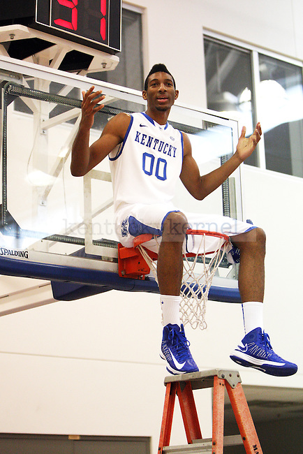 Marcus Lee sits in the basket during basketball photo media day in Lexington, Ky., on Thursday, September 12, 2013. Photo by Eleanor Hasken l Staff