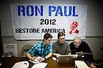Volunteer Robert Terhune, center, signs up volunteers at Ron Paul's presidential campaign headquarters in Reno, Nev., January 31, 2012.
