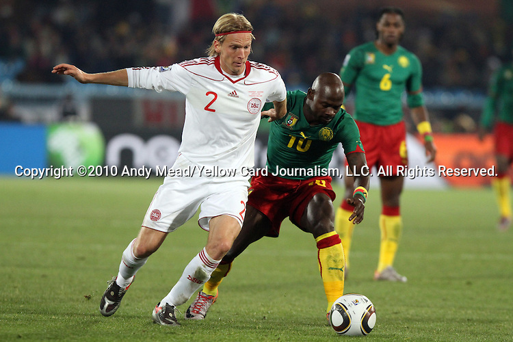 19 JUN 2010:  Achille Emana (CMR)(10) and Christian Poulsen (DEN)(2) battle for a loose ball.  The Cameroon National Team lost to the Denmark National Team 1-2 at Loftus Versfeld Stadium in Tshwane/Pretoria, South Africa in a 2010 FIFA World Cup Group E match.