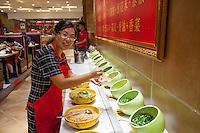 Chinese woman preparing food at a restaurant in Datong, China