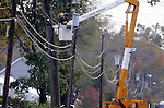 A CL+P linesman works on a transformer on Beech Road  in Enfield,  Monday, Oct. 31, 2011, as restoration continue. (Jim Michaud/Journal Inquirer)