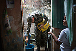 RECIFE, BRAZIL - JANUARY 9: A Brazilian soldier, working with the Environmental Health Department, adds a natural substance that eats mosquito eggs and larva in a bucket of water as soldiers go door to door encouraging and educating residents about how to take care of standing water, which provides perfect breeding ground for the zika-carrying mosquitoes, in Recife, Pernambuco, Brazil, on Saturday, Jan. 9, 2016<br /> <br /> The mosquito-borne Zika virus continues to spread in Brazil, alarming health officials and expecting mothers that their babies will be born with abnormal brain development called microcephaly. While researchers have yet to make a connection, Brazil has the highest number of babies born with mircocephaly - the most cases in Recife, Pernambuco - from mothers who tested positive to the Zika virus. There are about 3,530 suspected cases of zika-related microcephaly in Brazil.