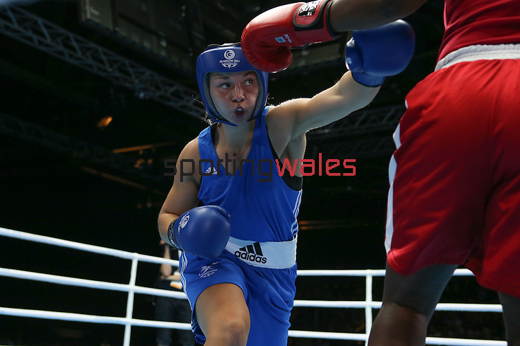 Glasgow 2014 Commonwealth Games<br /> Lauren Price, Wales (Blue) v Theresa London, Guyana (Red).<br /> Women's Middle (69-75kg)<br /> SECC<br /> 29.07.14<br /> ©Steve Pope-SPORTINGWALES